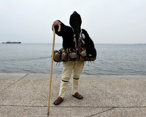 A participant poses for a picture during the 6th European Festival of Bell bearing traditions in Thessaloniki