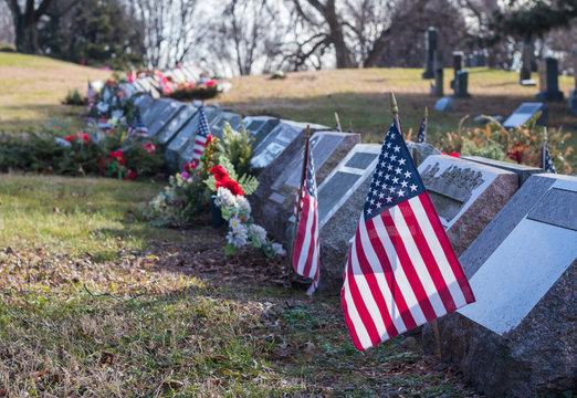 Small American flags and headstones at National cemetery.