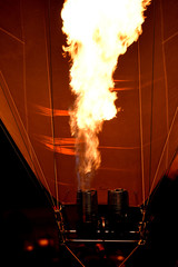 Close up of the burner buring on a hot air balloon at night