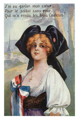 French historical postcard: Young beautiful redhead girl in a traditional dress, in a black cap with a tricolor. Alsace-Lorraine. France. world war one 1914-1918.