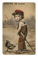 French historical postcard: A boy in a military cap with a sword on his belt pees in a German helmet-pikelhaube. world war one 1914-1918. Republic of france