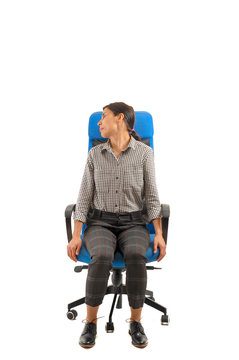 Woman doing exercises of his neck sitting on the office chair.