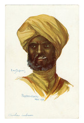 French historical postcard: portrait of an Indian cavalry in a turban  in military uniform, smoking cigarette, British colonial troops. world war one 1914-1918. India, England