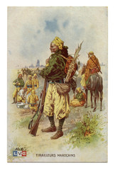 Old French postcard: Moroccan shooter colonial troops soldier of the line infantry in traditional dress in full combat layout, with a knapsack and a rifle. world war I 1914-1918, France.