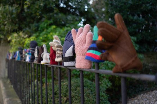 Many gloves on railings