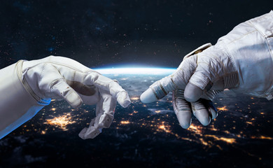 Astronaut and robot hands in the space. Earth planet on the background. Communication and technology. Cities lights. Elements of this image furnished by NASA Fototapete
