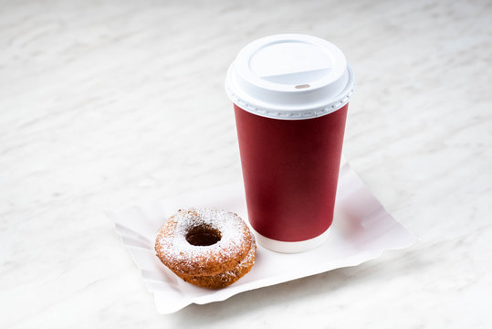 Takeaway coffee and donuts