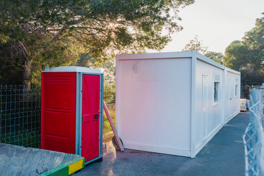 .Construction Site Living Container. Outdoor portable red toilet. WC.