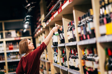 Photo of young woman in wine shop