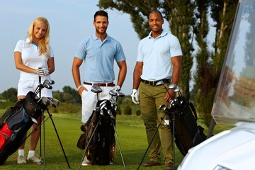 Golfers with golfing kit