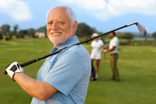 Portrait of mature male golfer
