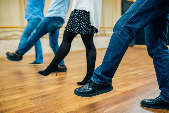 Dancing people in a row in the dance hall salon. Dancing school activity