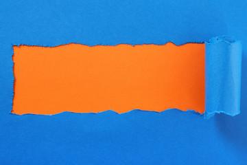 Torn blue paper center strip orange background