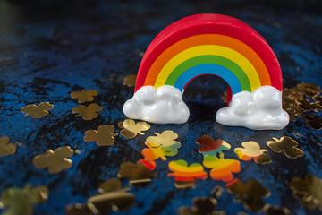 Saint Patrick's Day gold shamrocks reflecting colorful rainbow