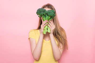 Woman have fun holding gluten-free organic green vegetable. Healthy nutrition food concept.