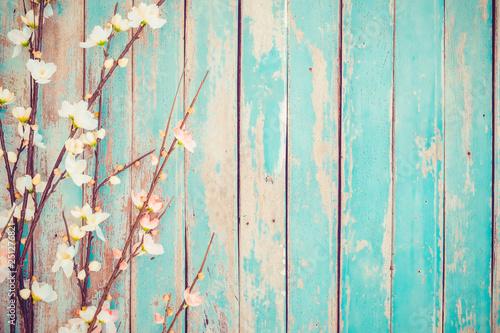 Wall mural Cherry blossom flowers on vintage wooden background, border design. vintage color tone - concept flower of spring or summer background