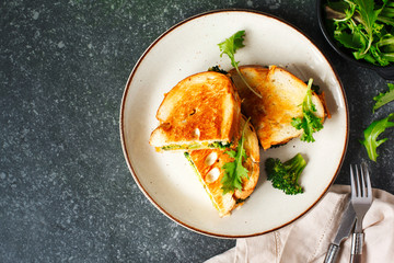 Broccoli and cheddar cheese sandwiches on plate
