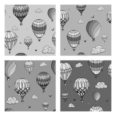 Set of vector seamless pattern with balloons in monochrome colors. Many differently colored striped air balloons flying in the clouded sky. Clouds and birds soaring in the sky. Travel and vacation.