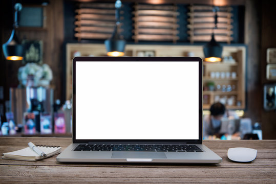 Desk Laptop with blank screen on table