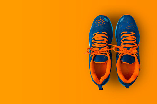 Sport shoes isolated on yellow background.