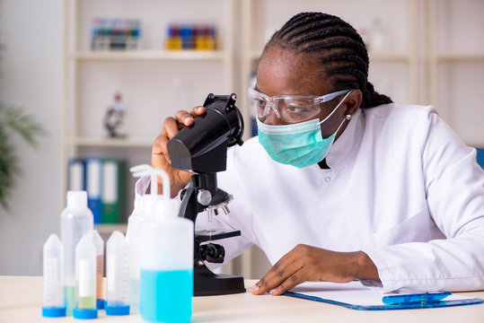 Young black chemist working in the lab