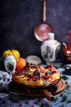Pumpkin, Brie, and Caramelized Onion Rolls with Cranberry Glaze.style rustic