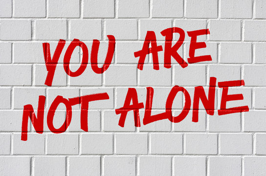 Graffiti on a brick wall - You are not alone