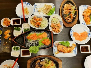 Japanese food style, Top view of shrimp steak, buta steak, sushi, shrimp salad, teriyaki sauce, salmon slice and rice on the table, japan food set in Restaurant