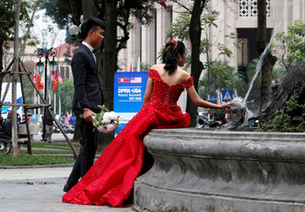 A couple poses for a wedding photo shoot outside Marriott hotel ahead of the North Korea-U.S. summit in Hanoi