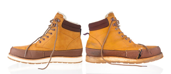 Wall Mural - New and used yellow winter boots on white background
