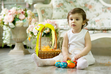 Beautiful little girl with Easter painted eggs.