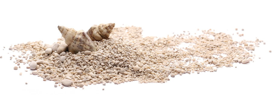 Sand with pebbles, rocks and seashells isolated on white background