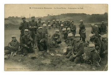 French historical photo postcard: infantry on maneuvers, a big halt, cooking dinner, soldiers eat and drink coffee. world war one 1914-1918. Republic of france