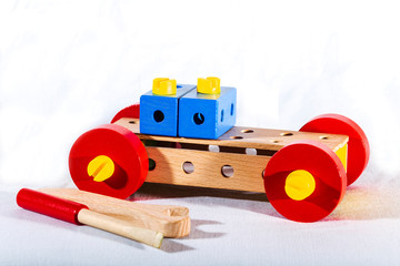 a car made by a child's hands from parts of a wooden constructor.