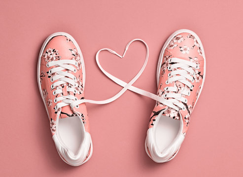 Coral colored Love, Hipster Set. Fashion Trendy Trainers with Heart. Vanilla color. Minimal Style. Summer Floral coral Sneakers. Flat lay. Art Design. Valentines day