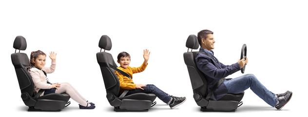 Father with son and daughter waving in car seats