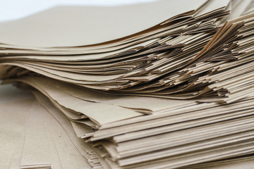 Side View Of Huge Stack of Recycled Paper close up. Business concept. Huge Stack of Recycled Paper envelopes closeup.