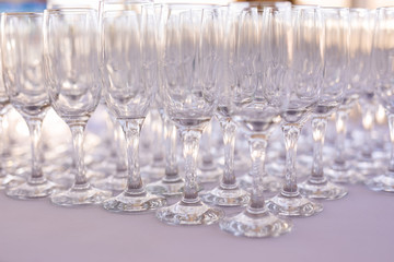 Blured background from wedding glasses filled with champagne