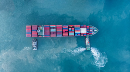 trug ship drag container ship vessel   to cargo international container yard port concept shipping by sea. - fototapety na wymiar