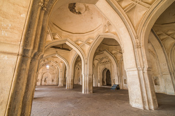 Arches and vaulted ceiling in the temple of white stone