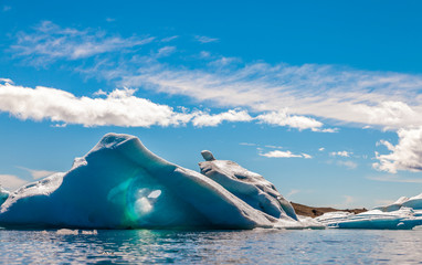 panorama of icebergs floating in the blue lagoon