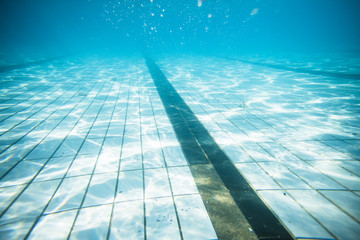 Wide angle underwater photo inside an olympic sized swimming pool with racing lanes