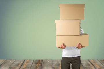 Man with cardboard boxes on background