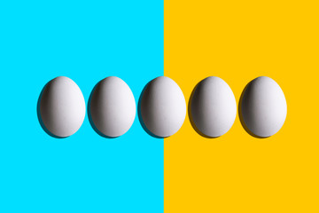 Abstract  Illustration,White chicken eggs in the blue and yellow background