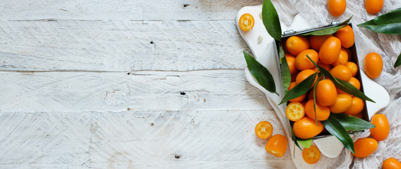 Kumquat fruits on a wooden background
