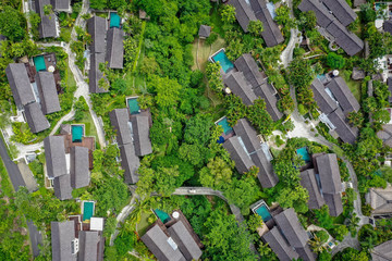 Villas with swimming pools and green trees, aerial view from above, Bali, Indonesia