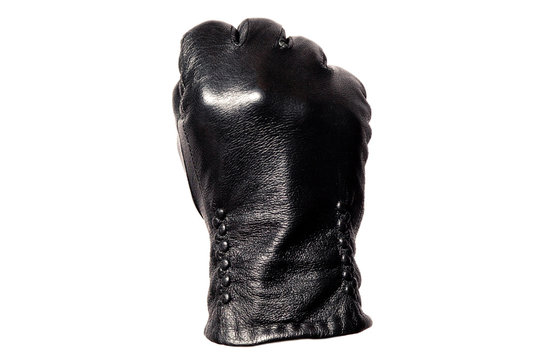 Closeup black leather glove, fingers showing fist sign. Isolated on white background. Concept symbols signs, numbers