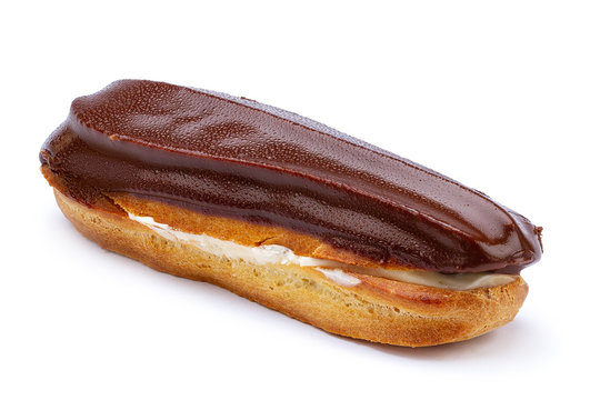 Traditional french dessert. Isolated eclair with custard and chocolate icing on white background. Sweet pastry products