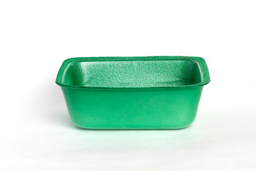 Empty green plastic tray isolated on white