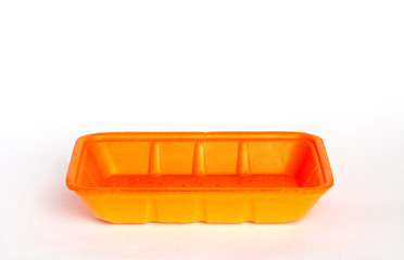 Orange food container on white background top view.